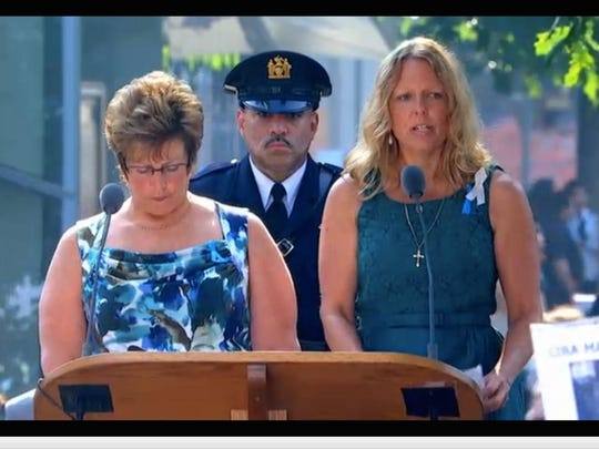 Gabrielle K. Gabrielli reading names of the fallen during the annual Sept. 11 remembrance ceremony.