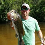 Local angler, Justin Hinote, with a nice bass he landed while fishing on the Blackwater River.