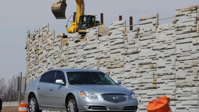 A vehicle on the off-ramp from eastbound I-465 to U.S. 31 passes work in progress in April 2014 on flyover connecting ramps for the U.S. 31 project in Hamilton County.