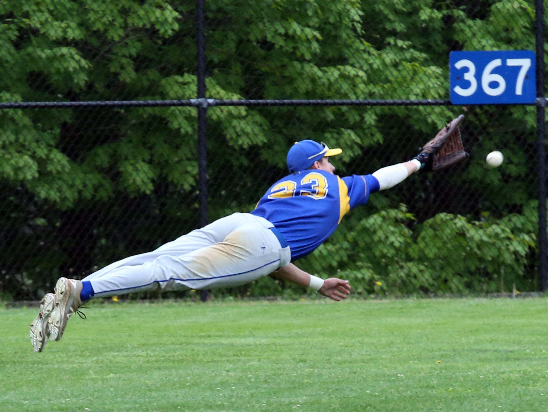 Ardsley's Bobby Wooten can't grab the shot by Albertus Magnus' Frank Margiotta during their Class B game at Ardsley High School, May 21, 2016.