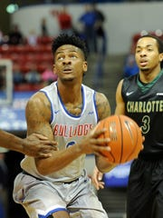 Louisiana Tech guard Alex Hamilton, center, scored