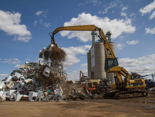 Heavy equipment operators at Pacific Steel and Recycling