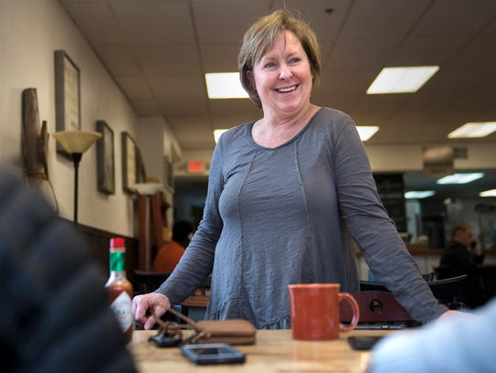 ComeUnity Cafe Owner Amy Crenshaw smiles as she chats