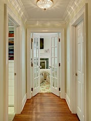 A hallway was notched out of this large master bedroom