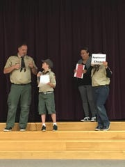 Moments before Bounty Hunter Den Leader and Assistant Cubmaster for troop 377 Chris Flicker was awarded the Honor Medal by the Boy Scouts of America, his troop had him participate in a surprise skit.