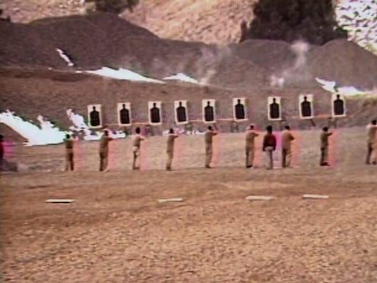 Members of the Rajneeshpuram commune practice shooting.
