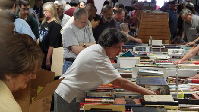 """Camden County Library to Stage Largest Book Sale in its History  Three-day event to offer over 50,000 Books, CDs, DVDs Videos, Recorded Books  [jpg attached]  [caption for Spring 2014 BkSl 023- v2 – 06-13-14.jpg. – The Camden County Library's semi-annual book sales always attract a lot of bargain hunters, book lovers and collectors as did this one in June 2014. This year's three-day fall sale starts Thursday, Oct. 15, 2015. (Camden County Library photo/Mark Amorosi)]    VOORHEES, NJ – Oct. 8, 2015 – The Voorhees branch of the Camden County Library is planning to hold its biggest book sale with over 50,000 books, CDs, DVDs, Videos and Books- on-Tape from Thursday Oct. 15 – Saturday Oct. 17.  Typically hundreds of book-lovers, bargain hunters and book dealers from the tristate area are attracted to the event where 99 percent of the items will be priced between fifty cents and two dollars, with nothing over three dollars, according to William Brahms, branch manager of the Voorhees library and chief organizer of the sale.   About ninety percent of the items are donated by customers, collectors and estates, with used library materials making up only about ten percent of the stock at the library's book sales.   The library's semi-annual sales have always attracted a lot of shoppers, but turnout and the number of items sold has been increasing steadily in the last few years. """"We are actually filling a void left by the changing book publishing industry, with fewer and few brick and mortar stores around. This year we will have ten more tables than we used last year,"""" explains Brahms.   This past spring the library surpassed its old two-day record by collecting almost $18,000 in sales. It hopes to set a new three-day record with 85 tables and other shelves filled with books and other media like CDs, DVDs, Videos and books-on-tape.   The doors will open 10 a.m. each day of the sale and it will end at 9 p.m. on Thursday and Friday with a 3 p.m. closing on Saturday, Oct. 17, the"""