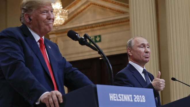 Russian President Vladimir Putin, right, gestures while speaking as U.S. President Donald Trump, left, looks on during their joint news conference at the Presidential Palace in Helsinki, Finland, Monday, July 16, 2018. (AP Photo/Pablo Martinez Monsivais)