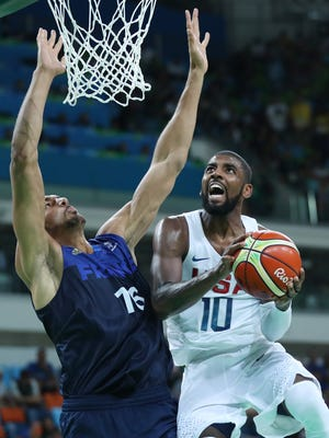 Aug. 14, 2016; Rio de Janeiro, Brazil; United States guard Kyrie Irving (10) prepares to shoot as France center Rudy Gobert defends during the men's preliminary round in the Rio 2016 Summer Olympic Games at Carioca Arena 1.