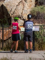 Cyclists make a stop at the Parowan Gap to look at petroglyphs during Saturday's Ride the Gap event in Iron County, June 4, 2016.