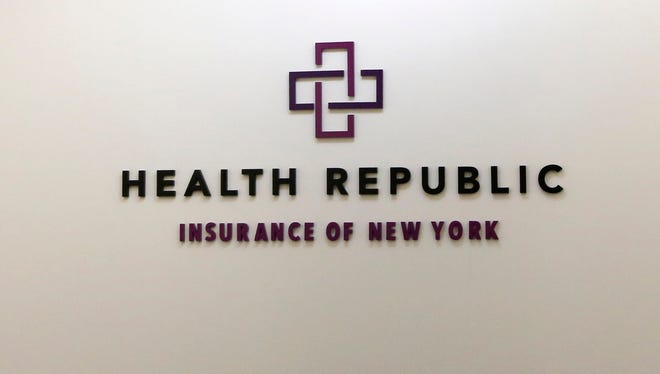A business logo adorns the wall outside the offices of Health Republic Insurance of New York, Nov. 18, 2015.