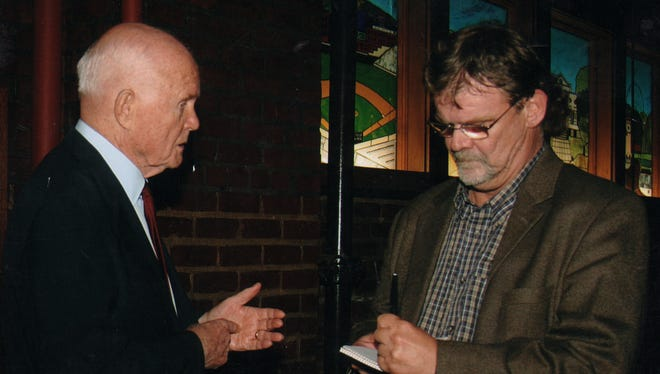 Former Enquirer reporter Howard Wilkinson, right, talks with retired senator and former astronaut John Glenn at a 2005 fundraiser in Mount Adams. Glenn was Wilkinson's boyhood hero.