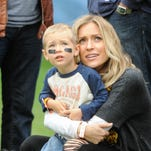 Kristin Cavallari holds son Camden at NFL game between the Chicago Bears and the Oakland Raiders on Oct. 4, 2015 in Chicago. The Bears won.