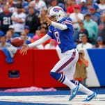 Buffalo Bills punter Brian Moorman (8) punts the ball during the second half against the Cincinnati Bengals at Ralph Wilson Stadium. Bengals beat the Bills 27 to 24 in overtime.