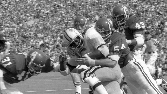 Oklahoma defensive lineman Jimbo Elrod tackles Wake Forest's Clark Gaines during a game in 1974.