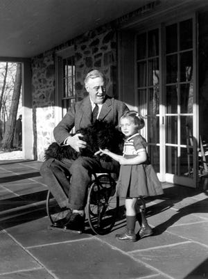 Franklin D. Roosevelt with his dog, Fala, and Ruthie Bie at Top Cottage in Hyde Park.