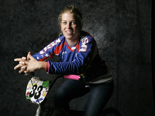 In this April 16, 2008 file photo, BMX cyclist Jill Kintner poses for a portrait during the USOC Media Summit in Chicago. Kintner is one of the world's best downhill mountain bikers, hurtling herself down rock-strewn trails at breakneck speeds in an Adrenaline-pounding version of the sport. But not unlike her early years riding BMX, she must settle for world championships and other high-profile races as the pinnacle of her career, the event is not part of the Rio Games, and likely won't be part of Tokyo 2020. (AP Photo/Charles Rex Arbogast)