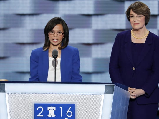 Ima Matul speaks about sex trafficking as Sen. Amy Klobuchar, D-Minn., stands next to her during the second day of the Democratic National Convention on Tuesday in Philadelphia.