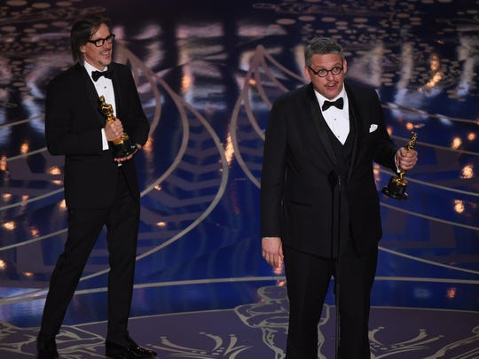 Charles Randolph (left) and Adam McKay accept the Oscar