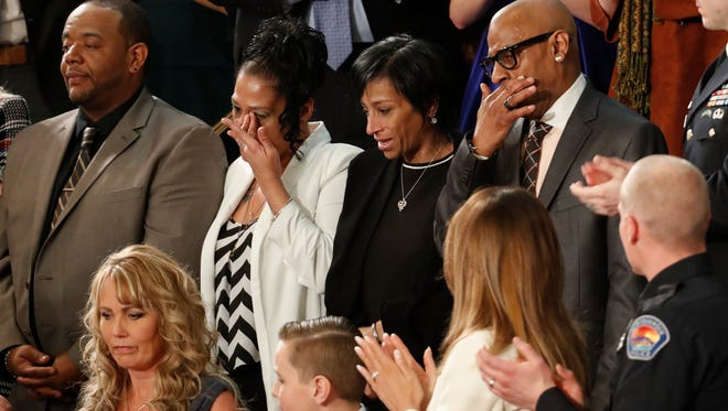 From top left, Robert Mickens, Elizabeth Alvarado, Evelyn Rodriguez, Freddy Cuevas, parents of two Long Island teenagers who were believed to have been killed by MS-13 gang members, during the State of the Union address to a joint session of Congress on Capitol Hill in Washington, Tuesday, Jan. 30, 2018.
