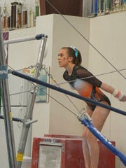 Anderson High School gymnast Mattie Bailey takes part