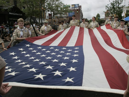 Boy Scout Troop 18, Freehold, carries a large American
