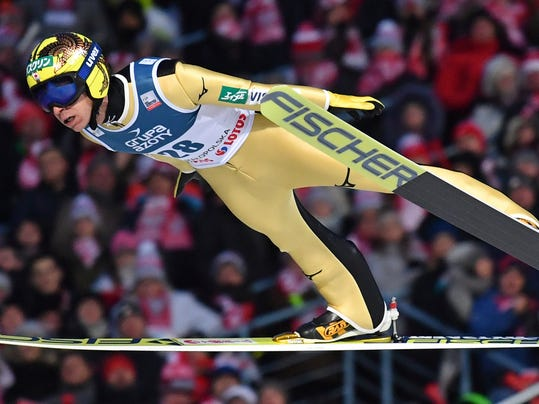 FILE - In this Jan. 28, 2018 file photo, Japan's Noriaki Kasai soars through the air during the 18th World Cup Ski Jumping competition, in Zakopane, Poland. Kasai is showing no sign of slowing down. One of six male ski jumpers representing Japan in Pyeongchang, the 45-year-old Kasai is taking part in his record eighth Olympics, surpassing Russian luger Albert Demchenko for the most appearances in the Winter Games.  (AP Photo/Alik Keplicz, File)