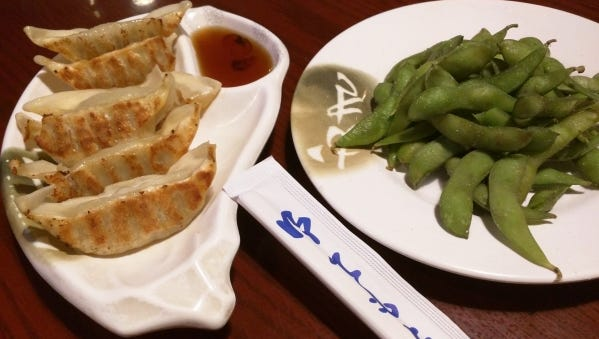 Izziban's goyza and edamame. Gyoza is six pieces of tender, deep-fried pork dumplings and a savory dipping sauce.