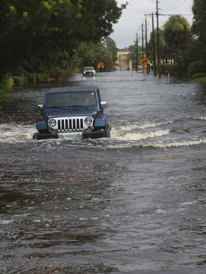 By Aug. 28, three days of relentless rains had swamped the Island Park neighborhood of Fort Myers, Fla. Ground-floor residences have 2 to 6 inches of water in them and emergency personnel were rescuing some people there. This Jeep tries to ford a flooded road in the area.