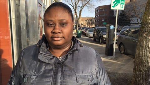 Tonya Dickerson, 35, has lived in Rochester since she was four. A University of Michigan graduate, she works for the state Labor Department. Dickerson said an elementary school argument, in which the N-word was used, made her aware of her race.