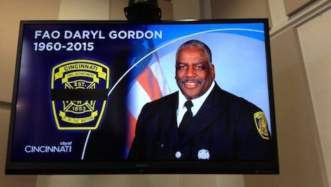 A photo of fallen firefighter Daryl Gordon, 54, is shown on a screen at a news conference Thursday morning.