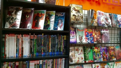 The walls in Phoenix Rising, a small comic book shop in Salisbury, are filled with comics and graphic novels.