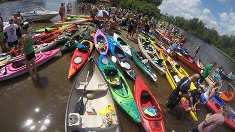 About 350 people participated in the 2015 paddle pub crawl, organized by Friday Night Fun.
