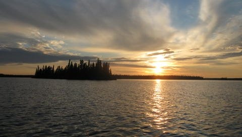 Picture: A setting sun on MacDowell Lake, Ontario, Canada, shows the beauty of this wilderness lake as evening approaches, as seen by our fishing crew made up of brothers Don and Frank Lohr and Jim and Roman Baumgart.