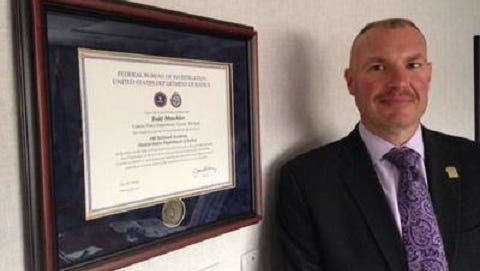 Todd Mutchler, shown here with his certificate from the FBI National Academy, will be Northville Township's next public safety director.