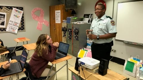 Paramedic and Opelousas High alumnus Matthew Johnson speaks to students about health care careers April 12.