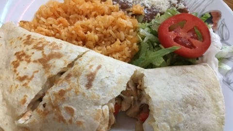 Antojitos Mexicanos' chicken quesadilla platter had a flour tortilla stuffed with grilled chicken, melted cheese, onions and mixed bell peppers. It came with a side of refried beans topped with cotija cheese crumbles and rice.