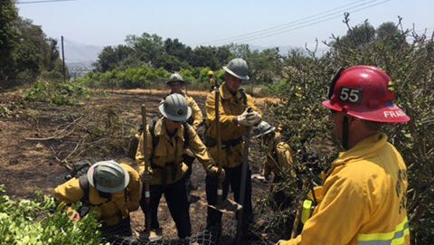 Firefighters put out a half-acre brush fire Monday afternoon in Camarillo.