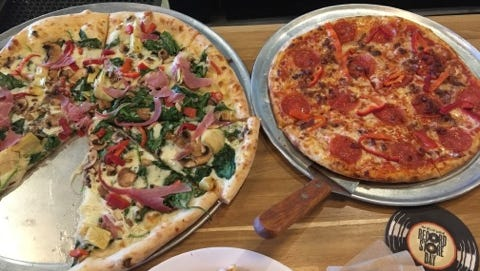 Tavola's Pizza is unique in that it pairs pizza with craft beer.