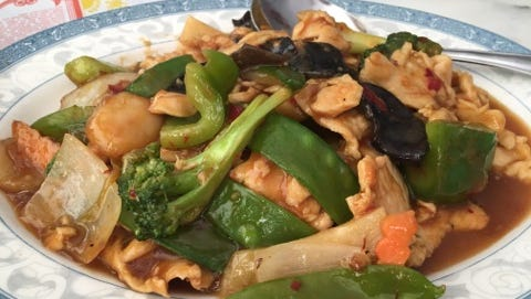Peking Chinese Restaurant's chicken Szechuan was thin-sliced chicken with broccoli florets, dried shiitake mushroom, thin-sliced bamboo shoots and an array of other veggies in what was supposed to be a hot and spicy Szechuan sauce but was more of a sweet chili sauce.
