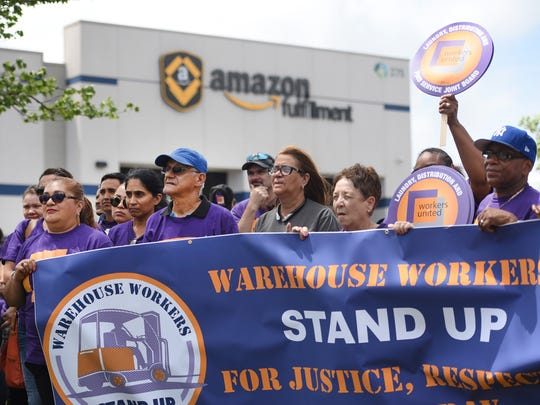 Members of a labor coalition, Warehouse Workers Stand Up,  hold a protest rally outside of Amazon Fulfillment Center in Avenel on 07/24/18 to launch a campaign for better treatment of warehouse workers.