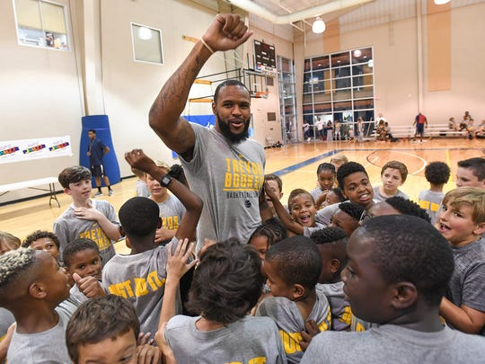 Former Clemson Tiger and current Indiana Pacer Trevor Booker is mobbed by campers during his 7th annual Trevor Booker Basketball Camp in Mauldin Friday, June 15, 2018.