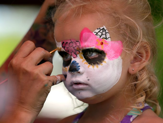 Izabelle Krause has her face painted during CommunityFest at Riverside Park on July 4, 2014 in Neenah, Wis.  Wm.Glasheen/Post-Crescent Media
