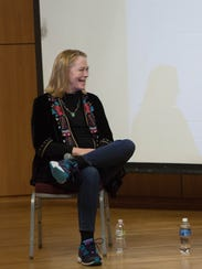 Cybill Shepherd laughs at a joke told by fellow actor Pam Grier during their panel discussion on diversity in the entertainment industry.