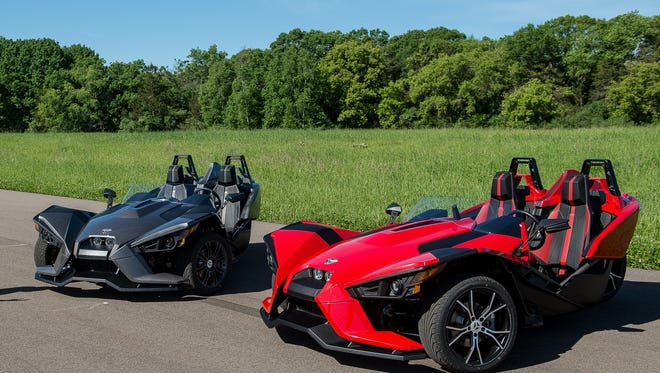 Two of Polaris Industries' Slingshot vehicles.