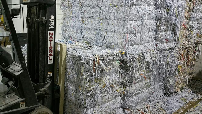 Shredded paper at Southeast Secure Shredding's facility in Vero Beach is baled and ready to be shipped and recycled.