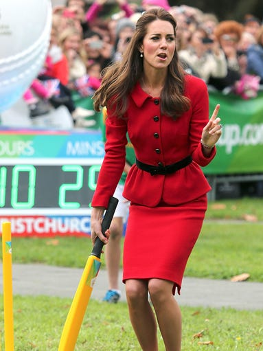 Britain's Kate, the Duchess of Cambridge, plays cricket in Latimer Square in Christchurch, New Zealand on April 14, 2014. Kate's dilemma: What to pack for a two-week trip, when your itinerary includes everything from state receptions and church services to toddler playdates and cricket games?