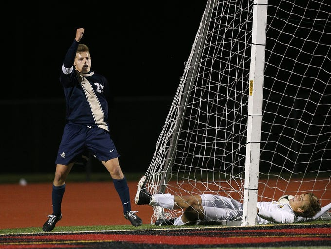 Pittsford Sutherland's John Mozrall celebrates his