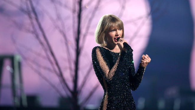 Taylor Swift performs at the 58th annual Grammy Awards on Monday.