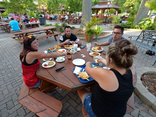 Customees enjoy the evening, and the food at Mike Linnig's